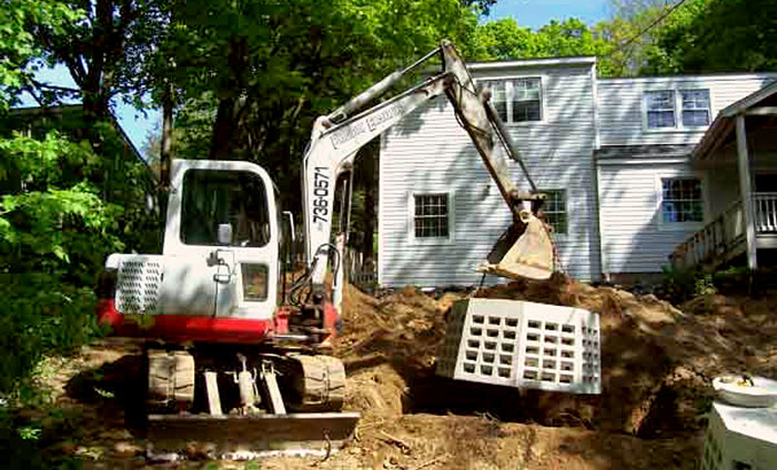 Excavating Machine Installing Septic Tank
